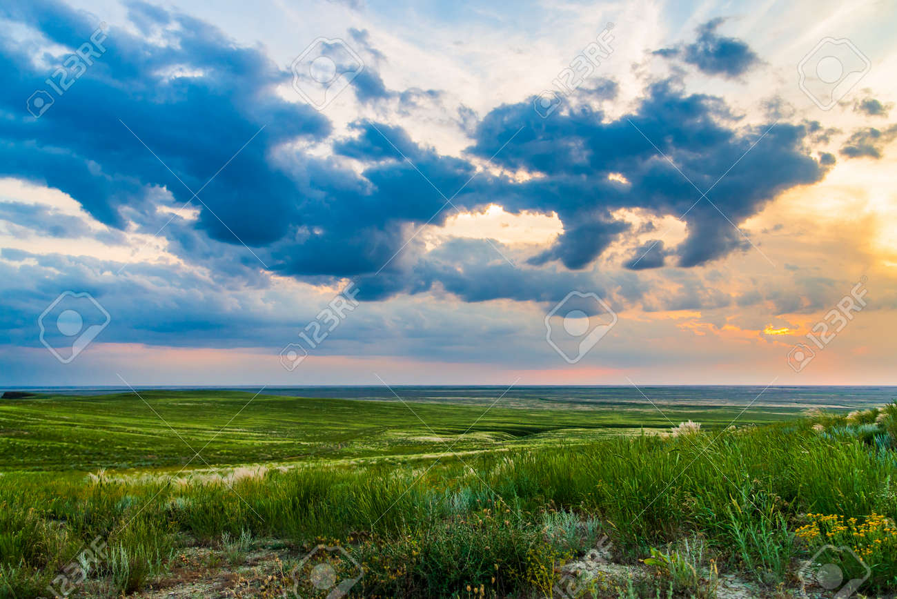 Scenic sunset with clouds in sky in steppe. - 159446779