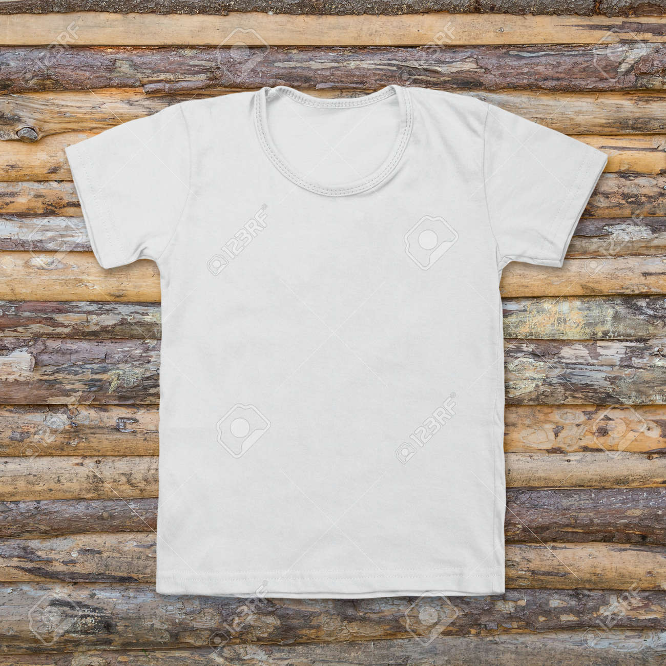 Plain wood table with hipster brick wall background stock photo - In Plain Clothes White Blank T Shirt On Dark Wood Desk Stock Photo