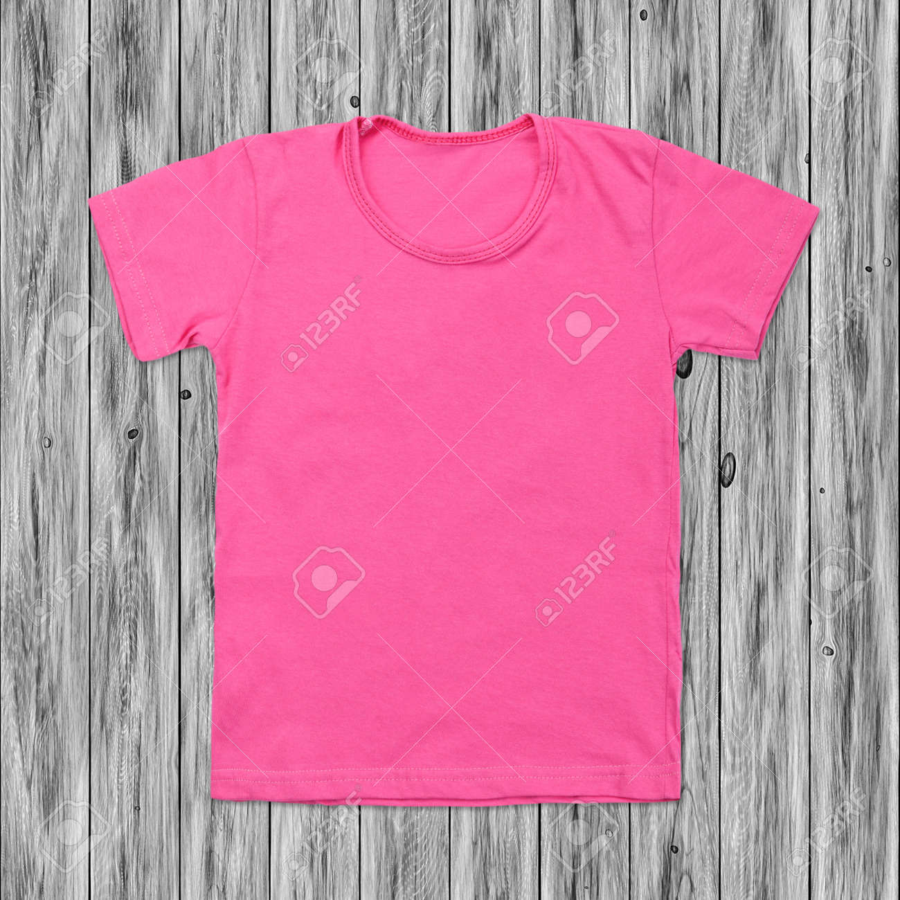 8482b408 Pink Blank T-shirt On Dark Wood Background. Stock Photo, Picture And ...