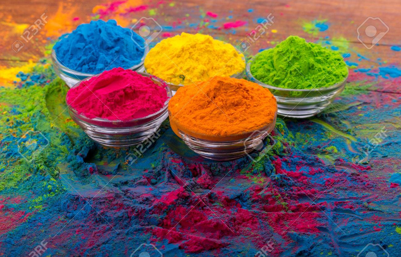 Holi color powder. Organic Gulal colours in bowl for Holi festival,..