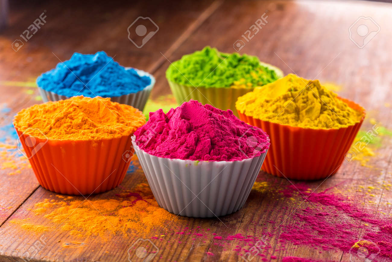 Holi color powder. Organic Gulal colours in bowl for Holi festival,..
