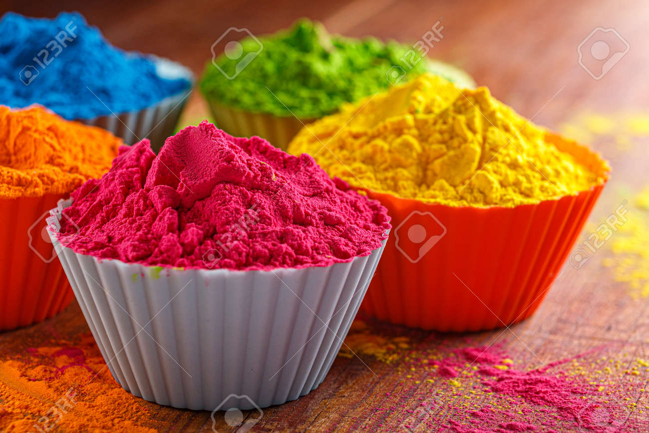 Colorful traditional holi powder in bowls. Happy holi. Concept Indian color festival called Holi. Organic Gulal dust - 167665551