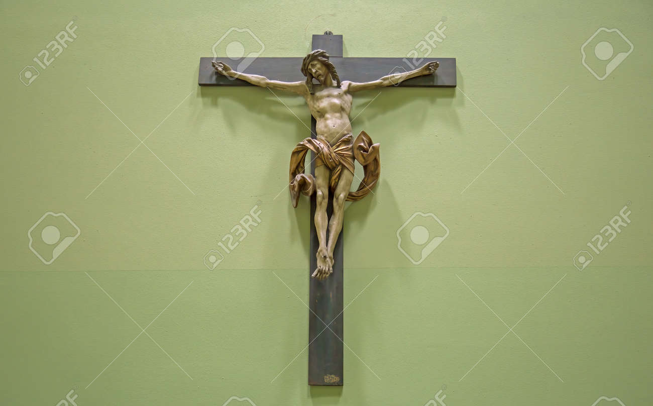 Christian background with crucifix of Jesus Christ on distressed concrete wall with copy space - 169669055