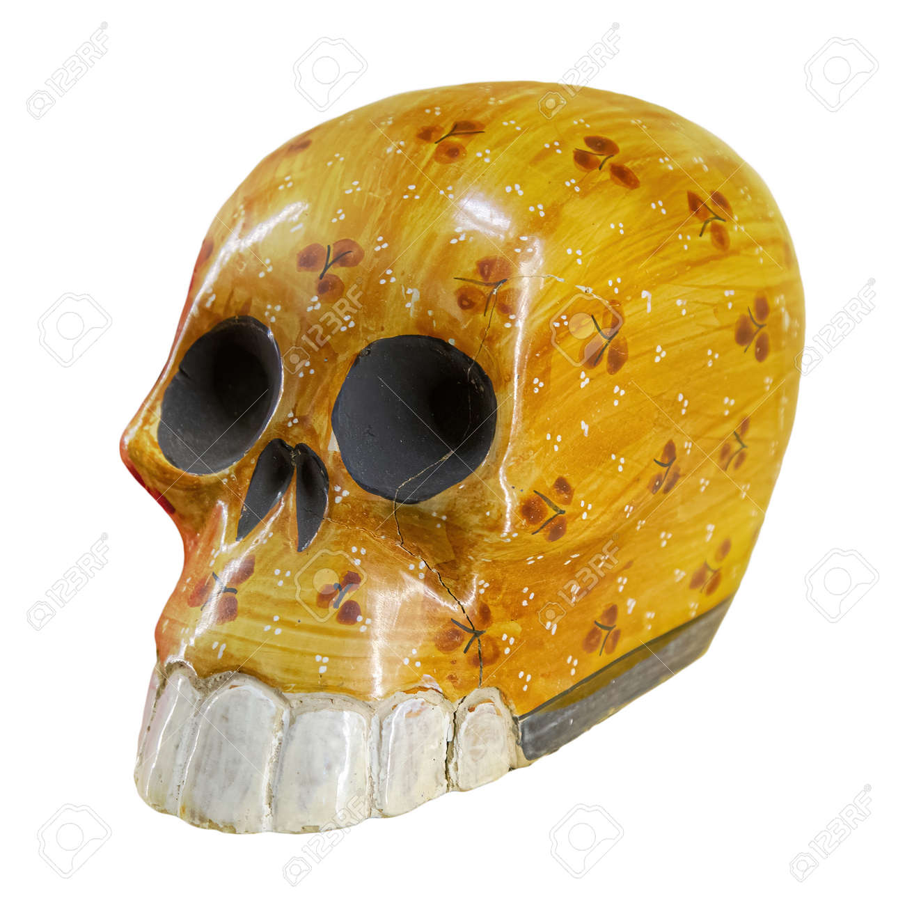 Typical Mexican skull painted isolated on white background. Dia de los muertos. Creative and minimal Day of the Dead or Halloween layout. Skull yellow - 169669219