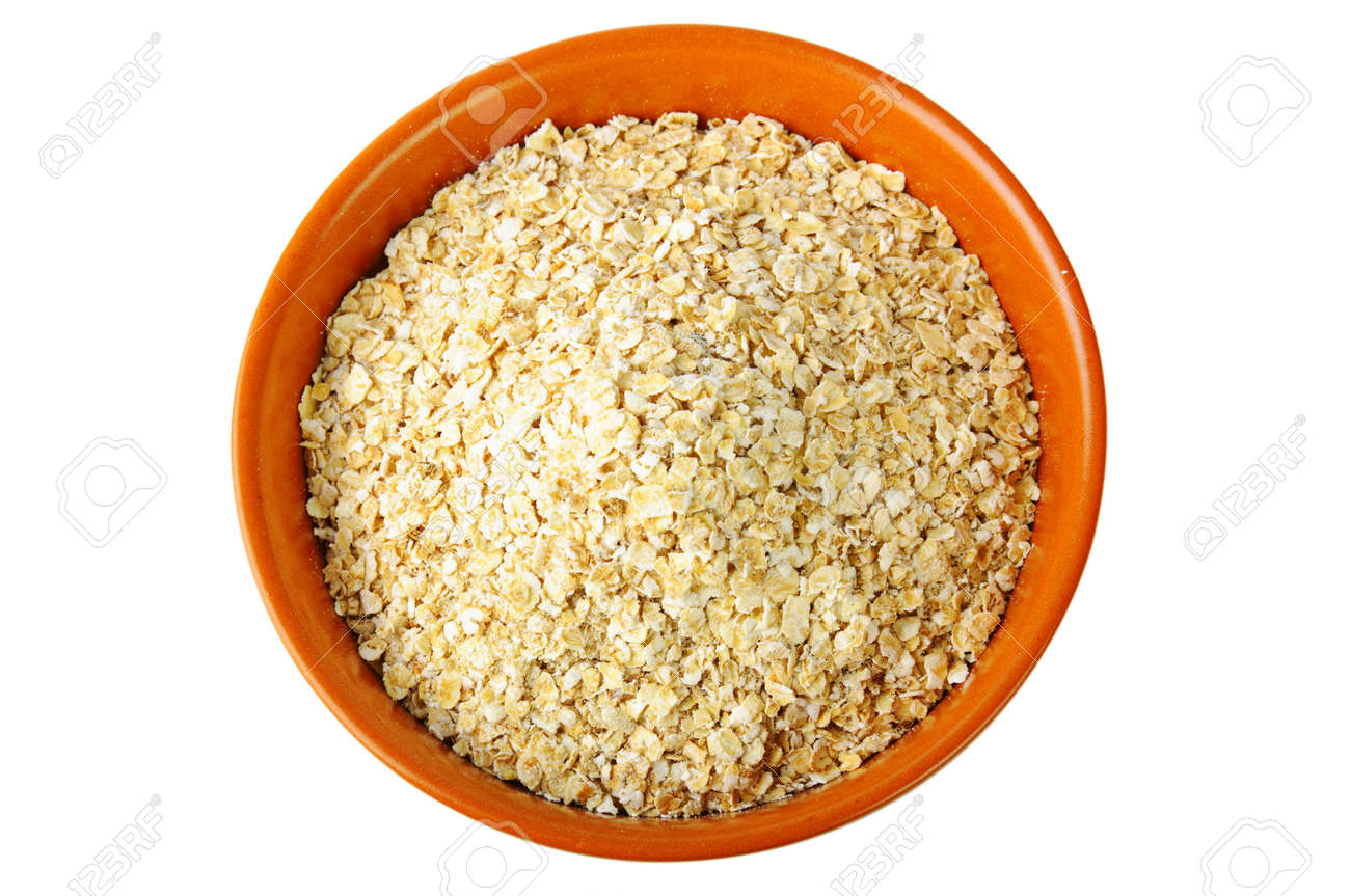 dry oat grains in brown clay bowl Stock Photo - 10103596