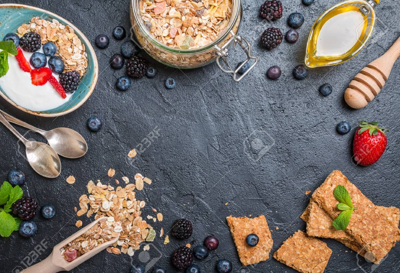 Top view blackboard with copyspace from granola bars and healthy homemade granola with toasted oats, yogurt, honey and berries. Health and diet concept. - 54420030