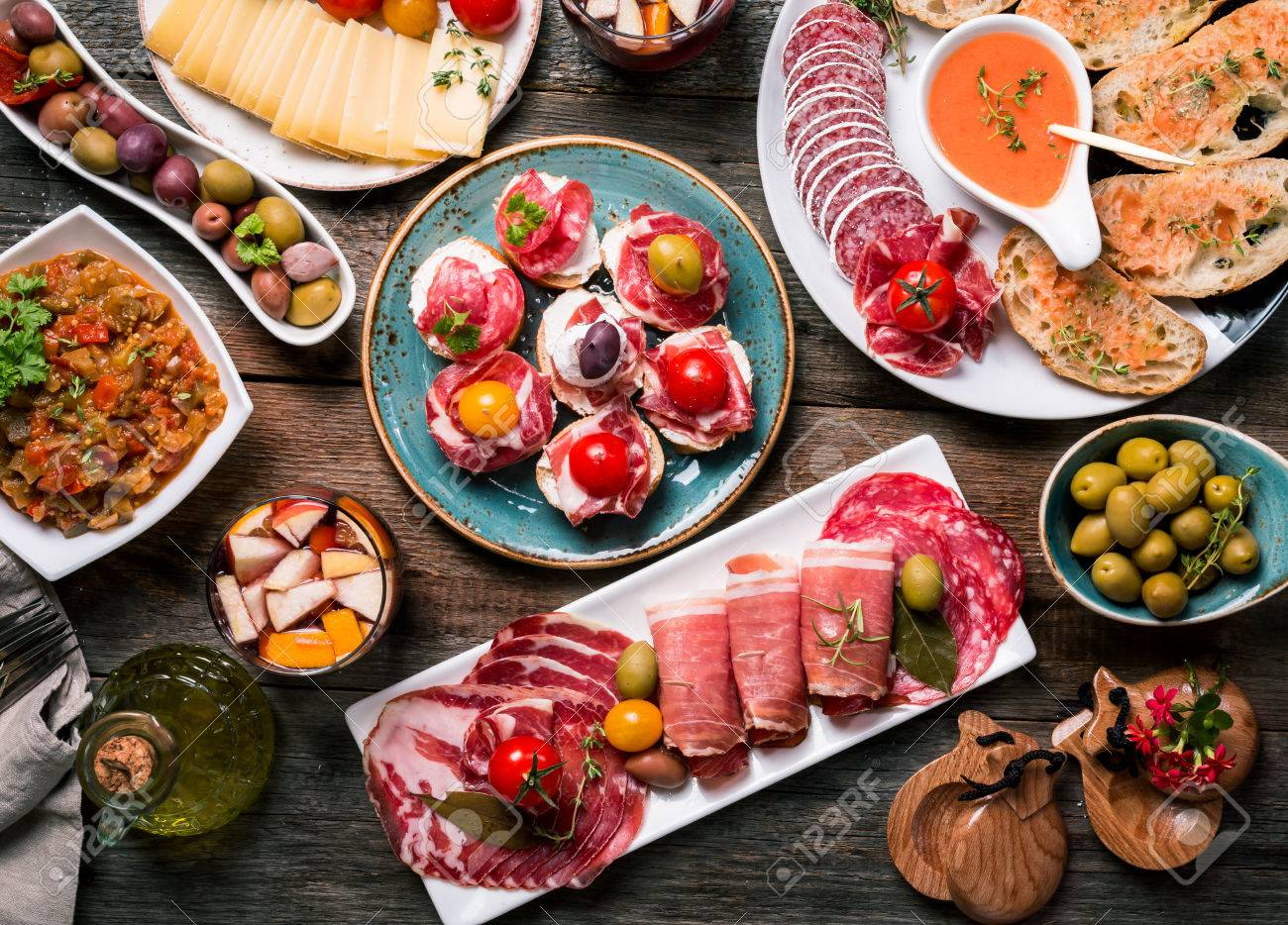 spanish tapas and sangria on wooden table top view stock photo