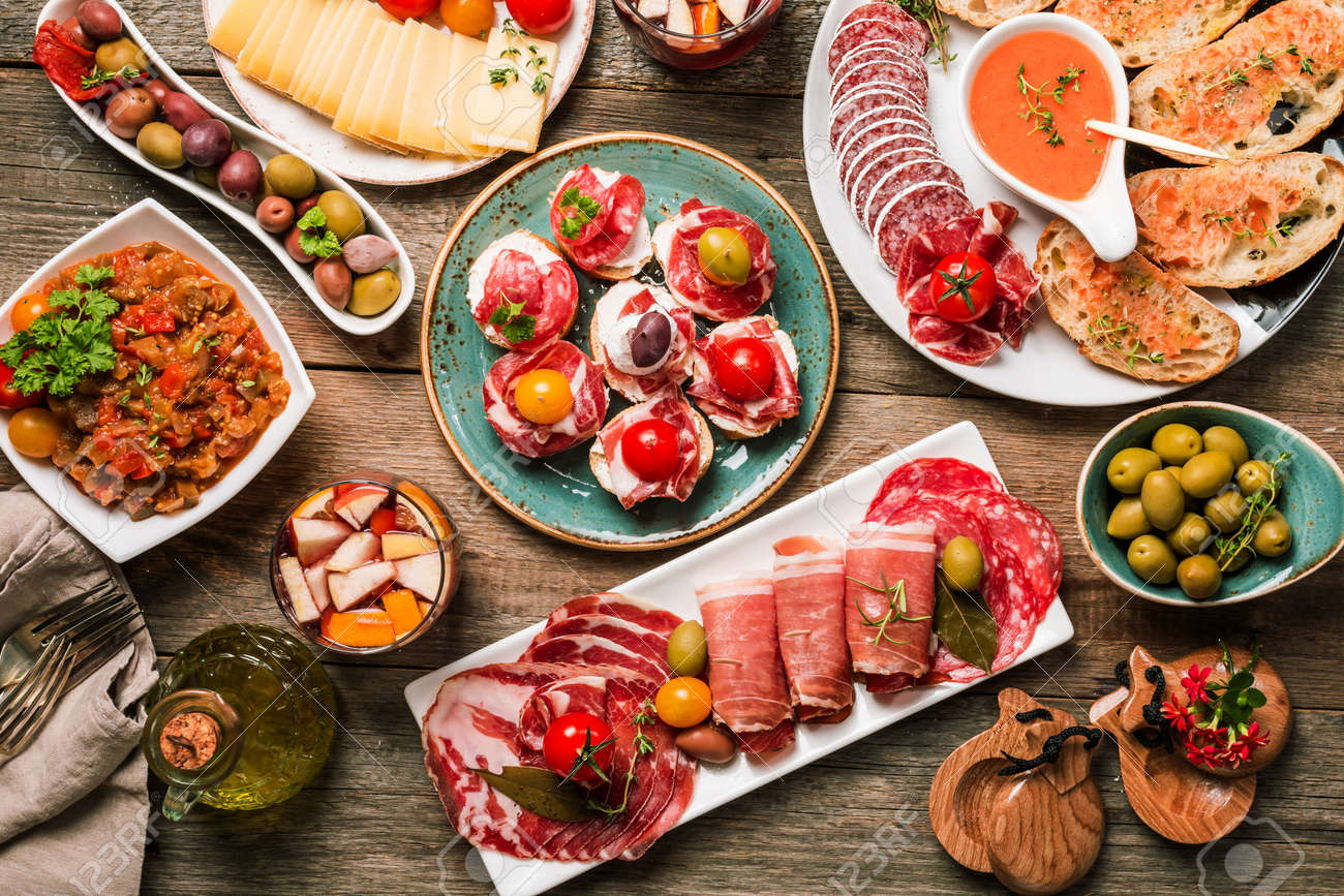 spanish tapas and sangria on wooden table, top view - 69707044
