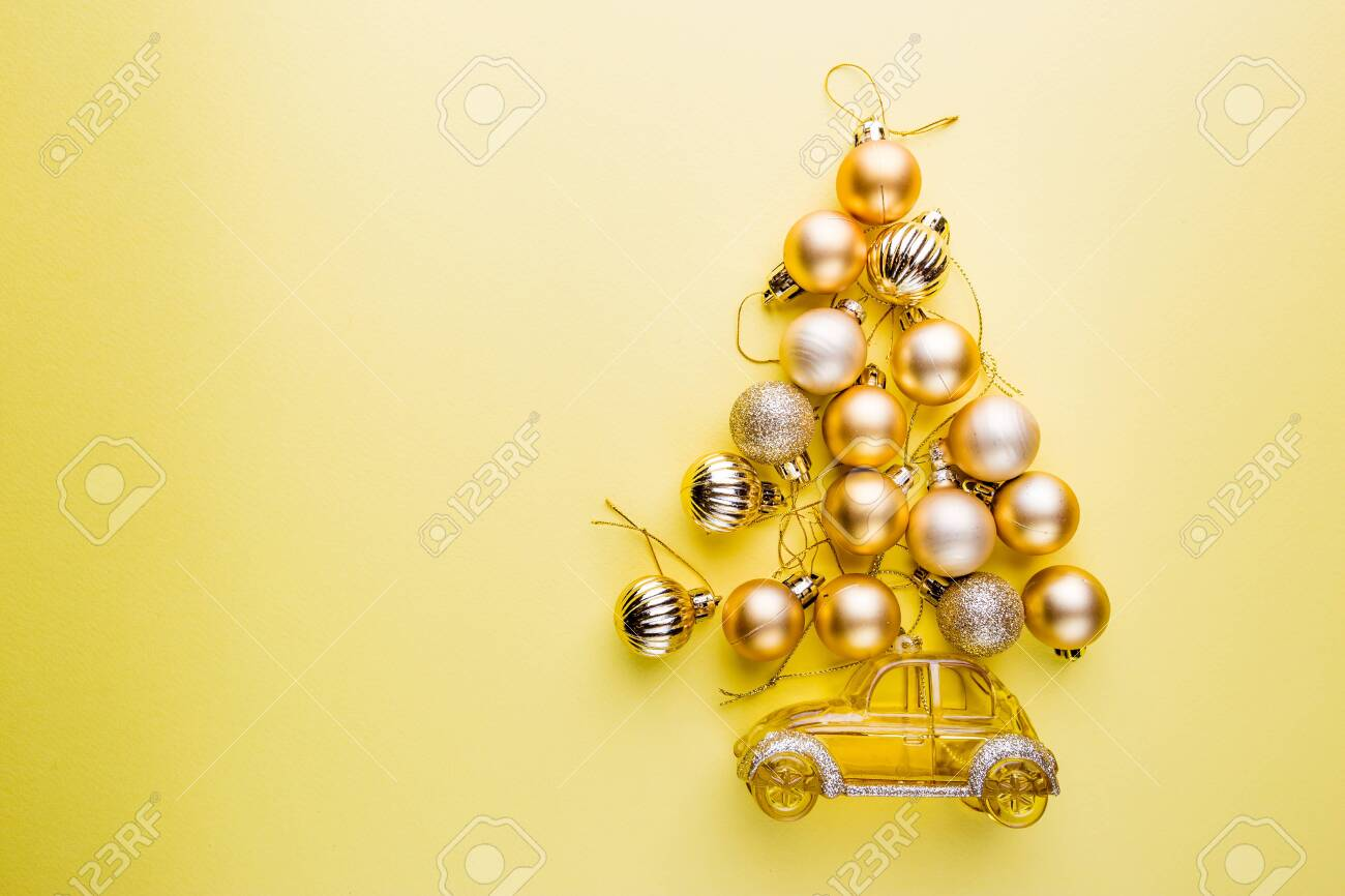 Christmas Tree Made Of Christmas Balls On Yellow Background Stock Photo Picture And Royalty Free Image Image 127868014