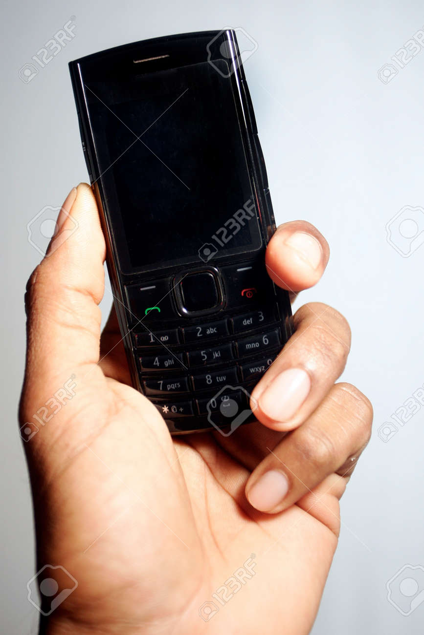 Mobile phone in hand Stock Photo - 18712865