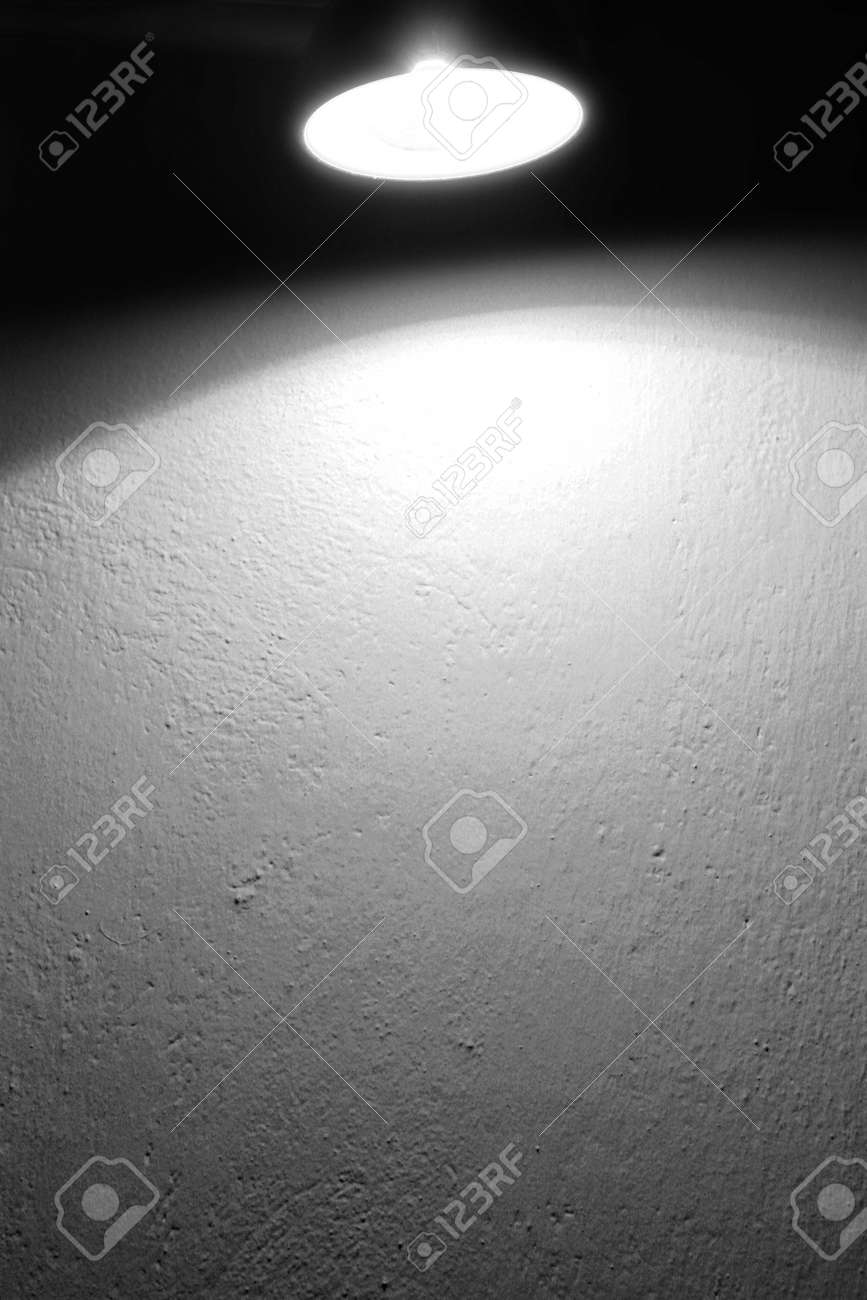 wall background texture and spot light lamp and beam of light black and white background Stock Photo - 17209147