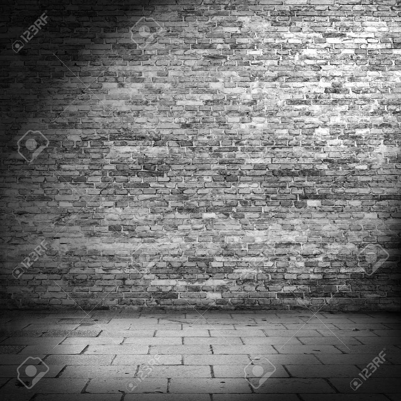 Dark Brick Wall Background In Basement With Beam Of Light Stock Photo