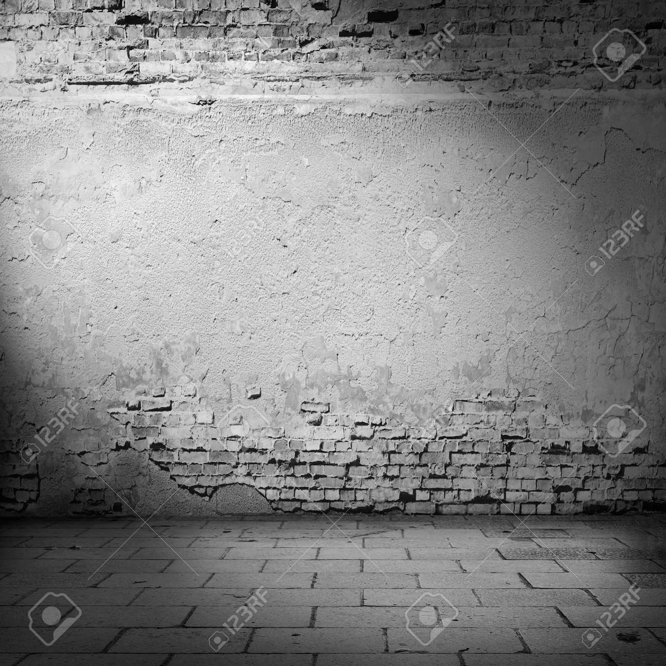 Stock photo white wall background basement with beam of light plastered wall and bricks