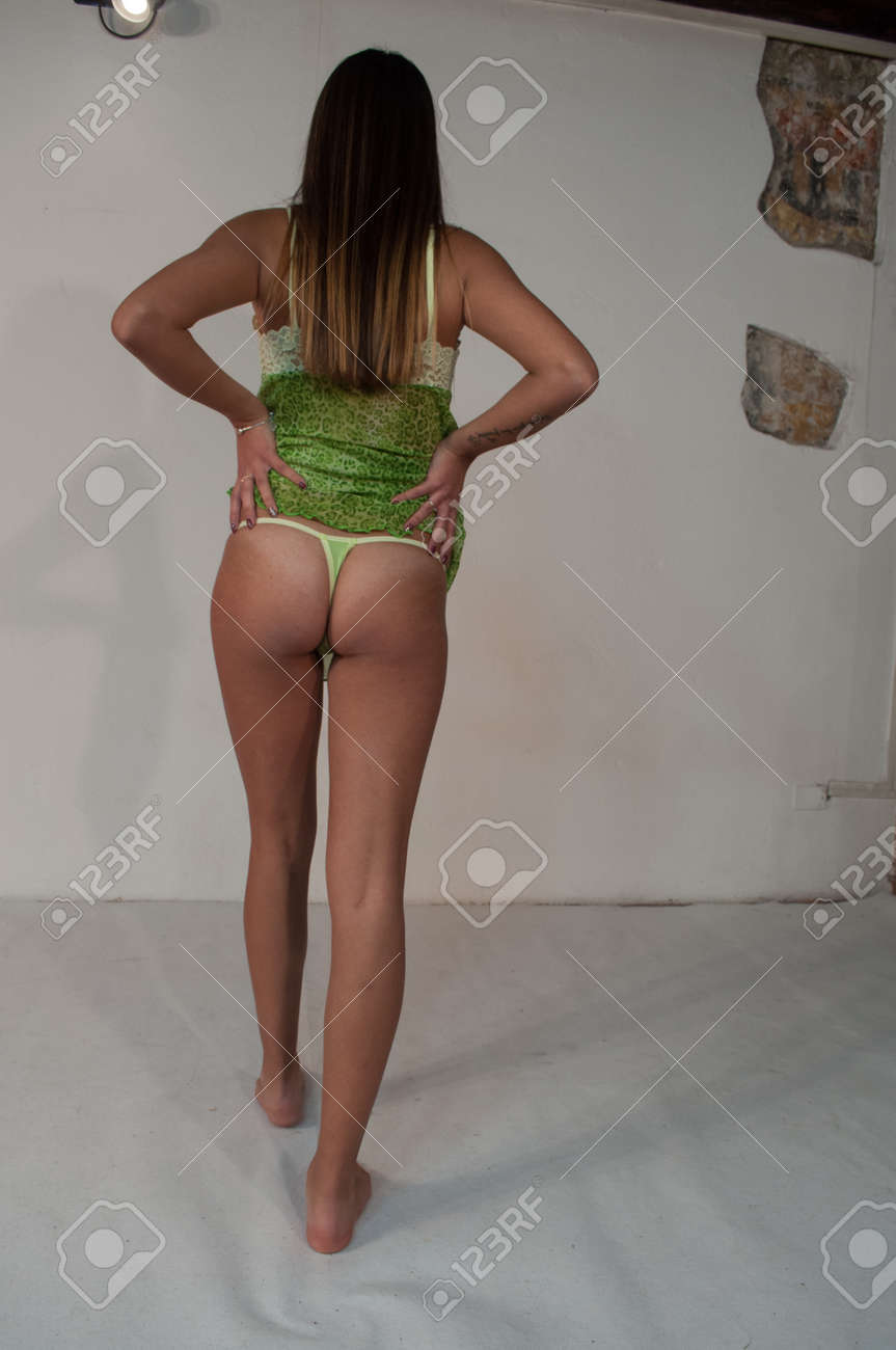 Sexy Girl In Green Underwear Posing In Photo Studio With A Nice
