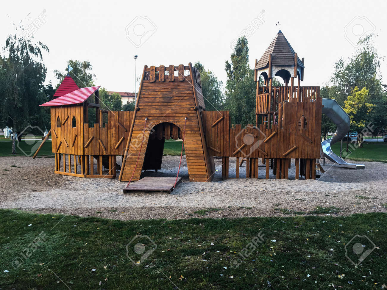 Wooden Playground For Children In The Public Park Surrounded