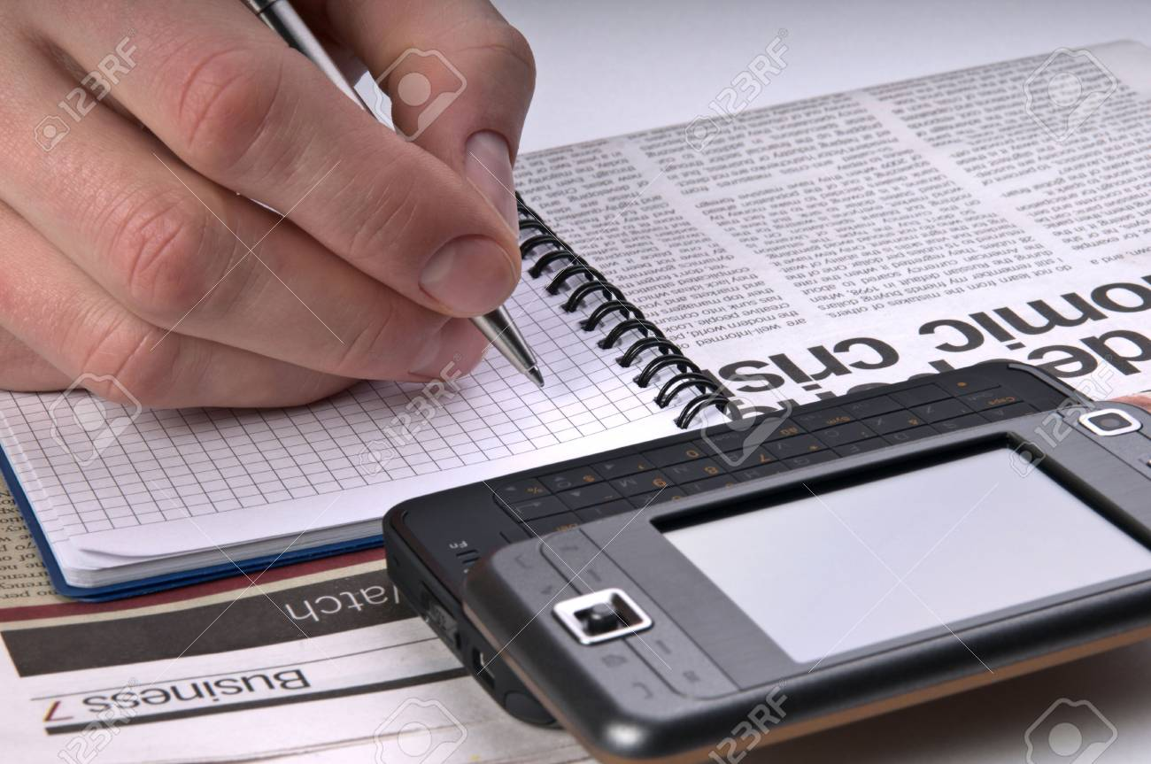 Phone on newspaper make a notes close up Stock Photo - 5045866
