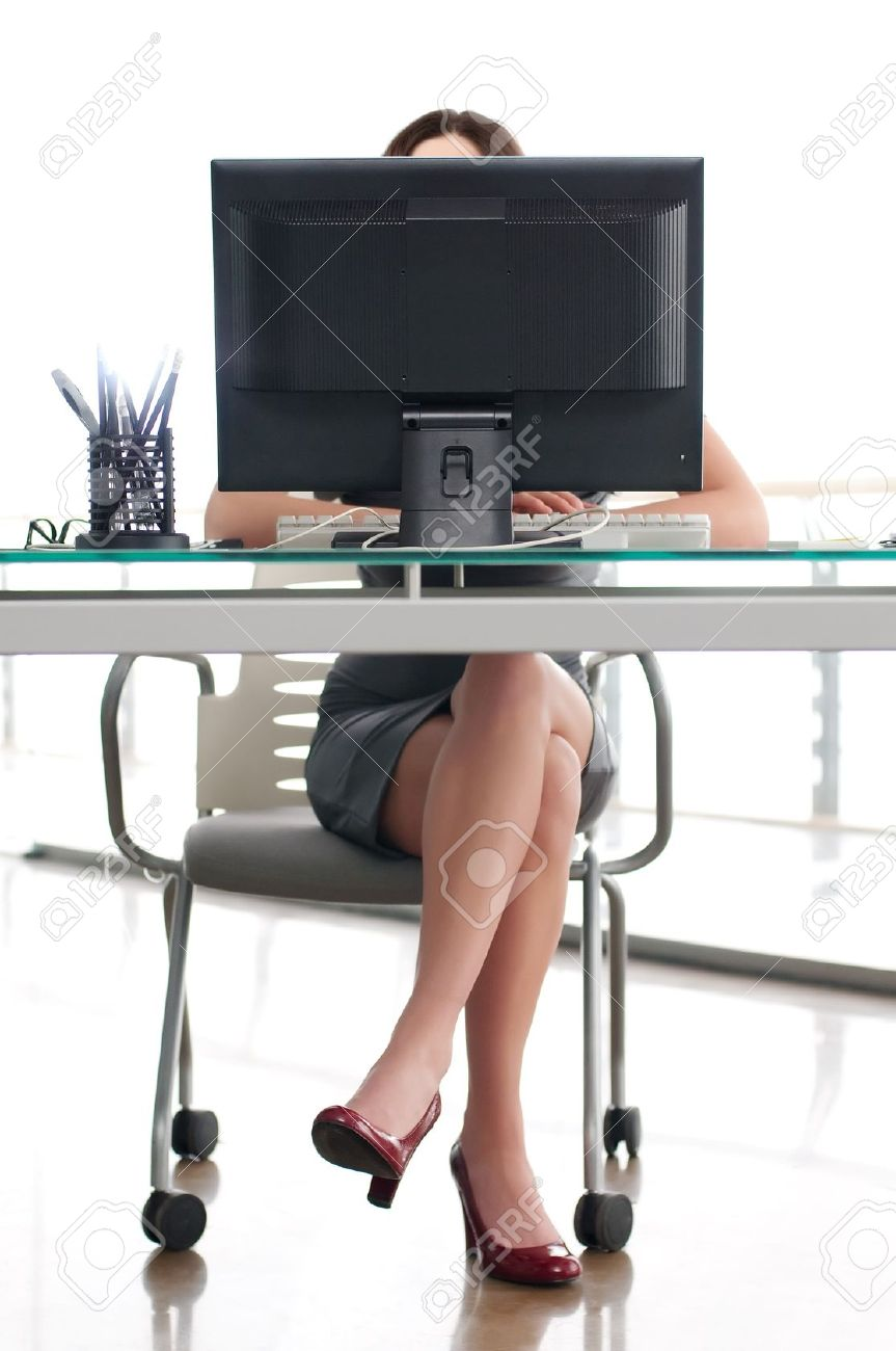 girl sitting at his work place behind a computer screen Stock Photo - 10894339