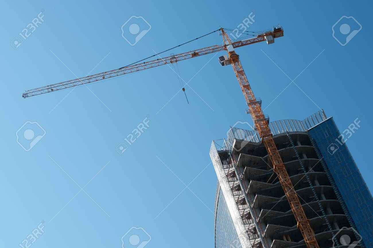 Construction site of modern office buildings with high crane on blue sky background Stock Photo - 11194293