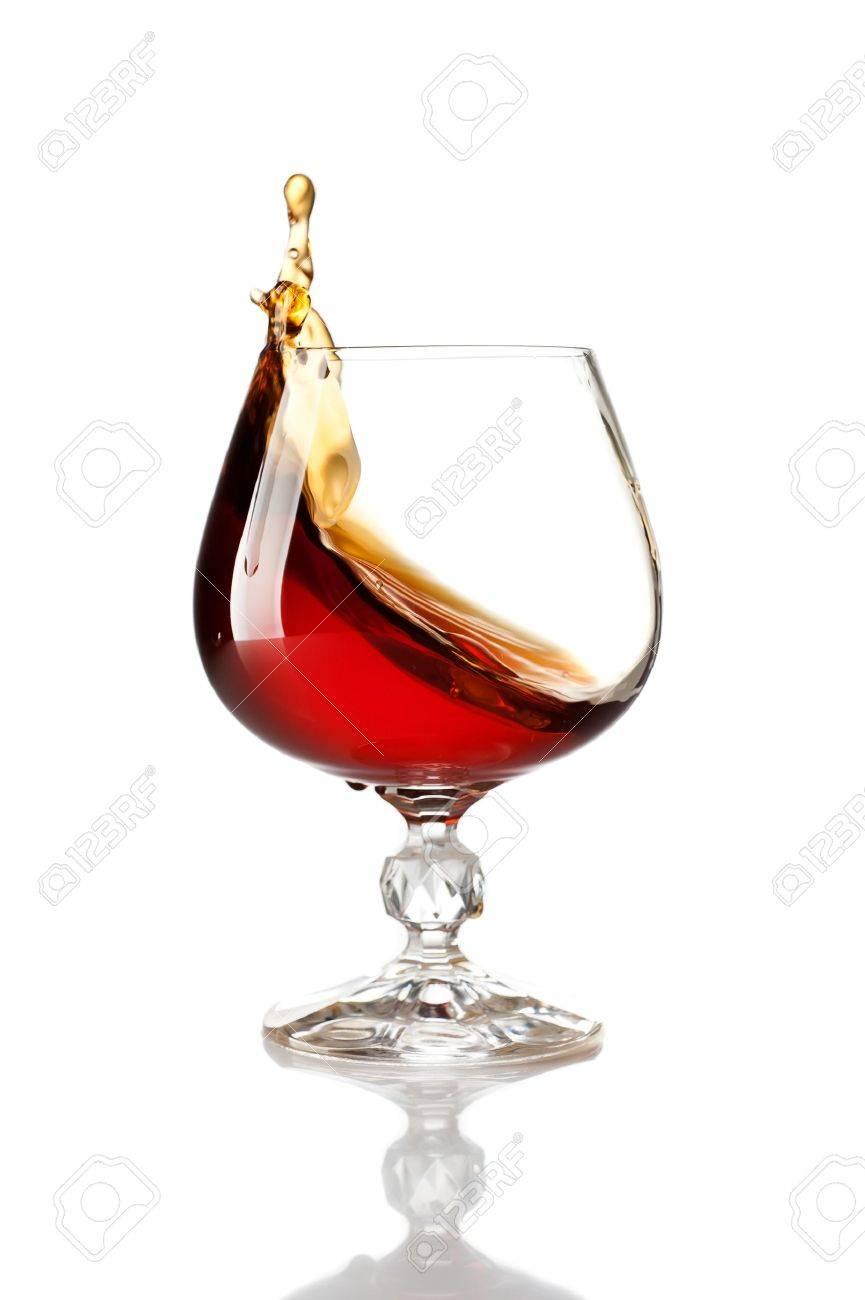 Splash of cognac in glass - 18784445