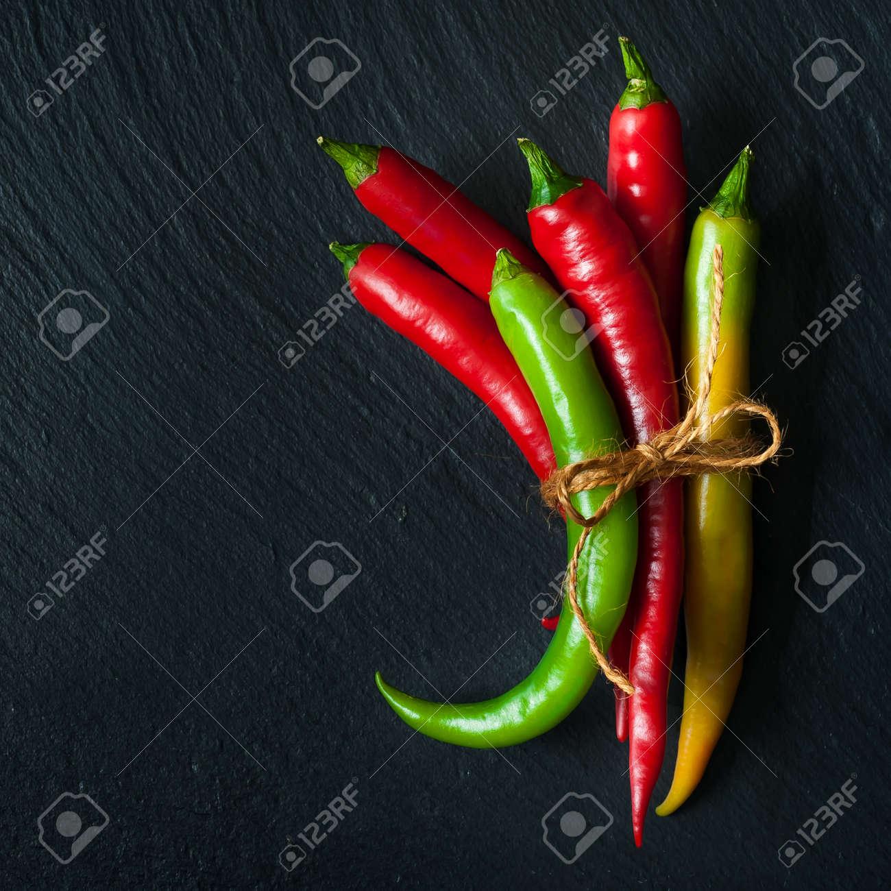 Hot chili pepper on a slate chalkboard - 22738304