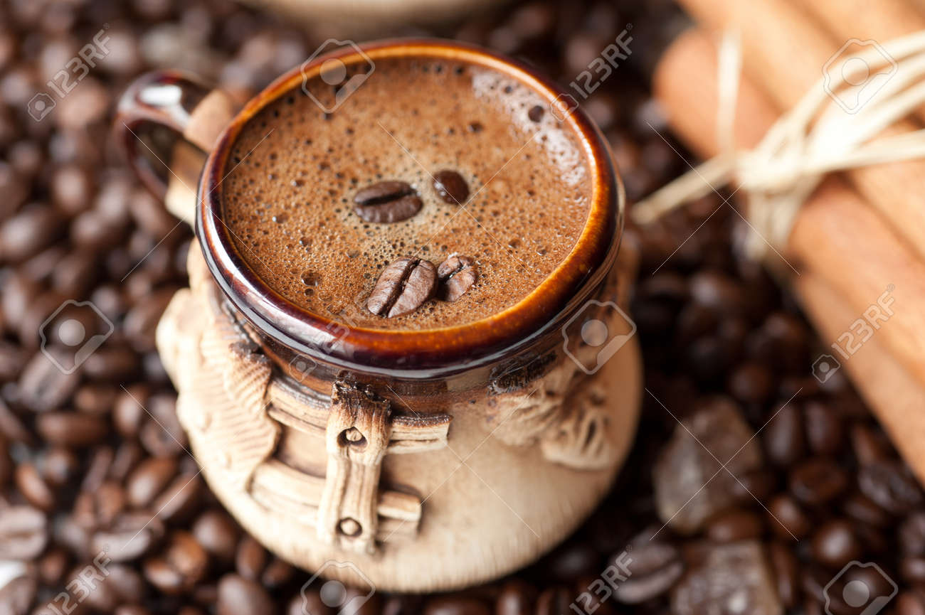 cup of coffee with coffee beans - 22743064