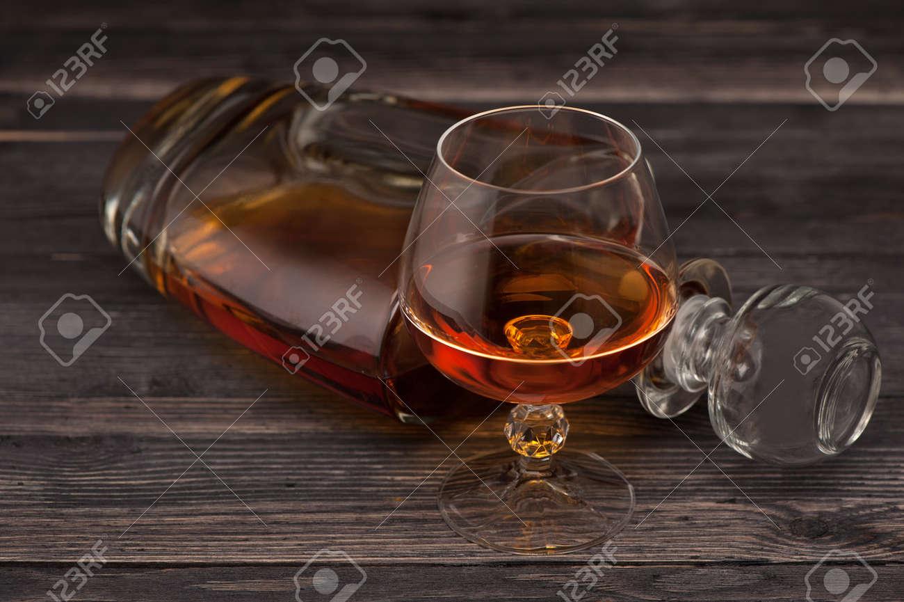 Cognac on wooden - 27543381