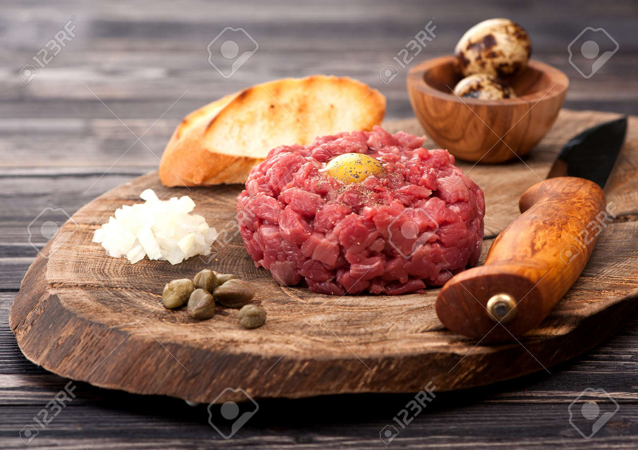Steak Tartare with capers and fresh onions - 32489820