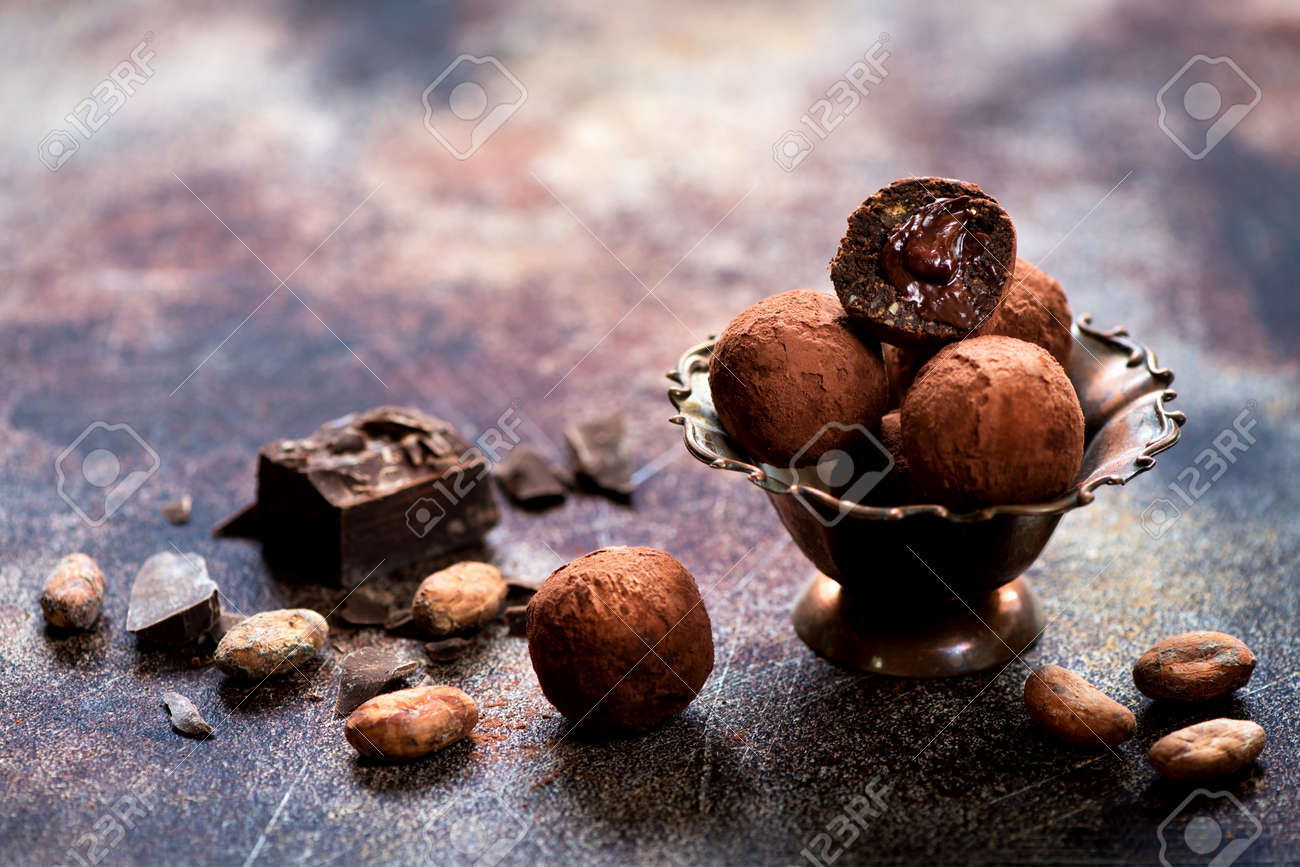 Chocolate sweets, cocoa beans and chocolate - 149496989