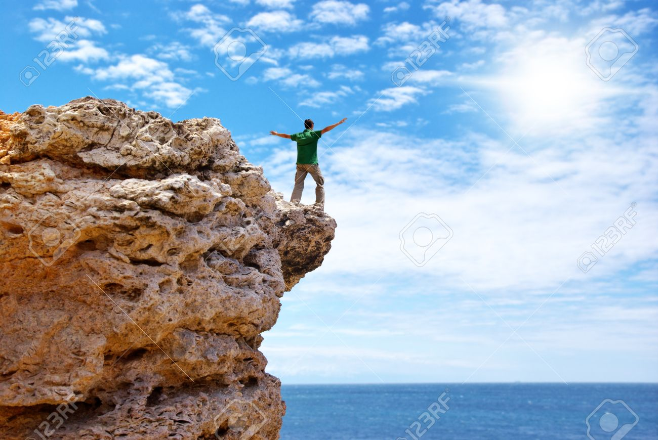 Man on the edge of cliff. Emotional scene. Stock Photo - 8364305