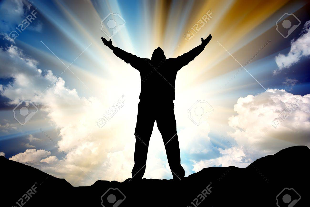 Silhouette of the holy cross on background of storm clouds stock - Love Of God Silhouette Of Man And Sunshine On Sky Background