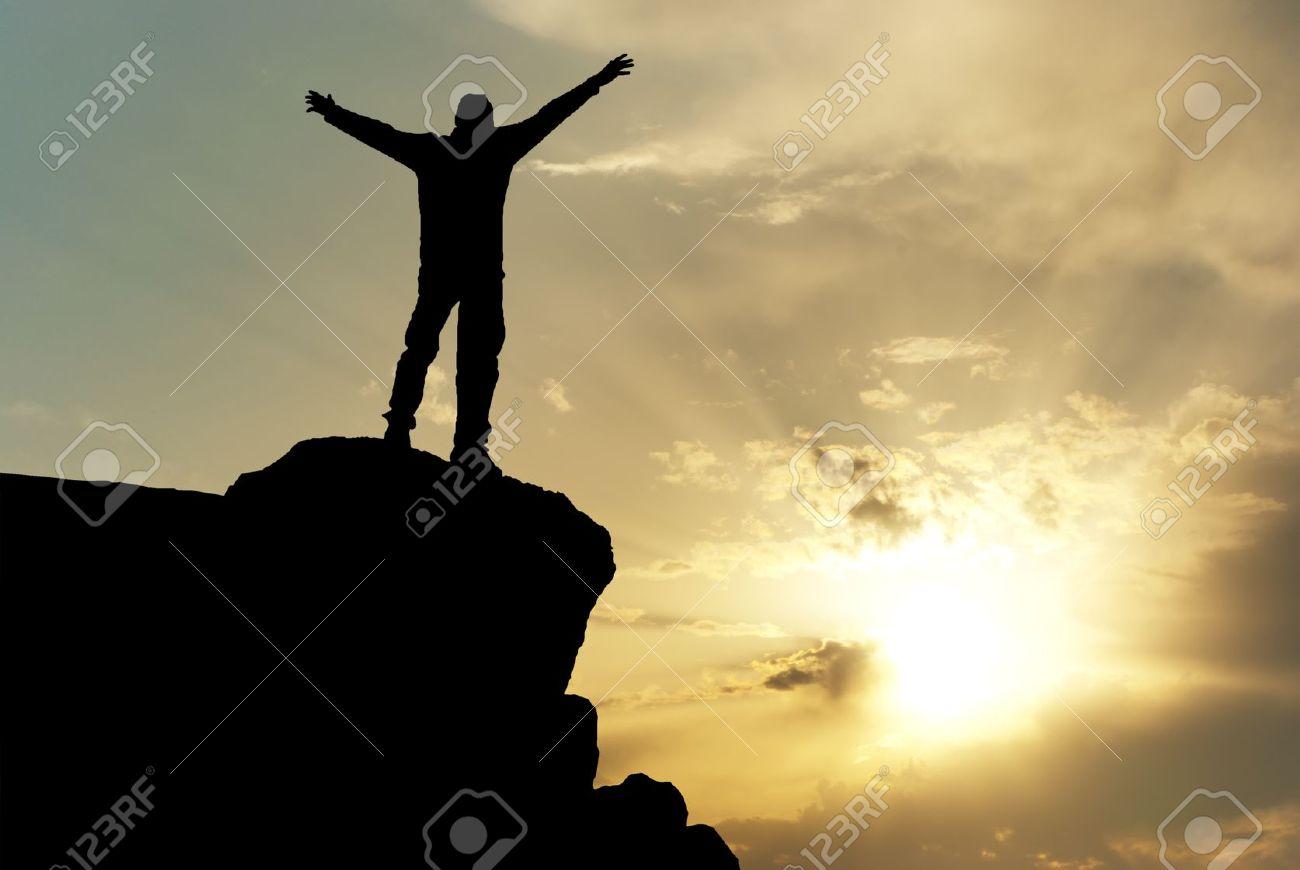 Man on top of mountain. Conceptual design. Stock Photo - 8931902