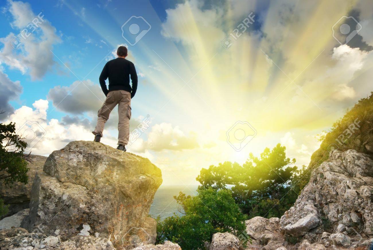 Man on top of mountain. Conceptual design. Stock Photo - 8931941