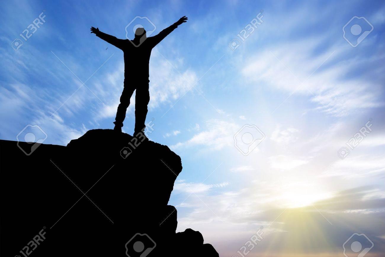 Man on top of mountain. Conceptual design. Stock Photo - 10120898