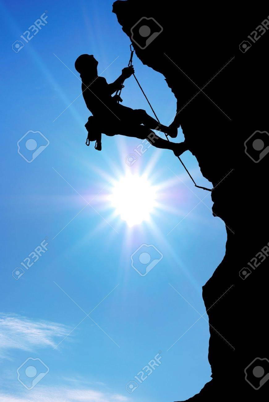 Mountain climber on the top. Stock Photo - 10998472