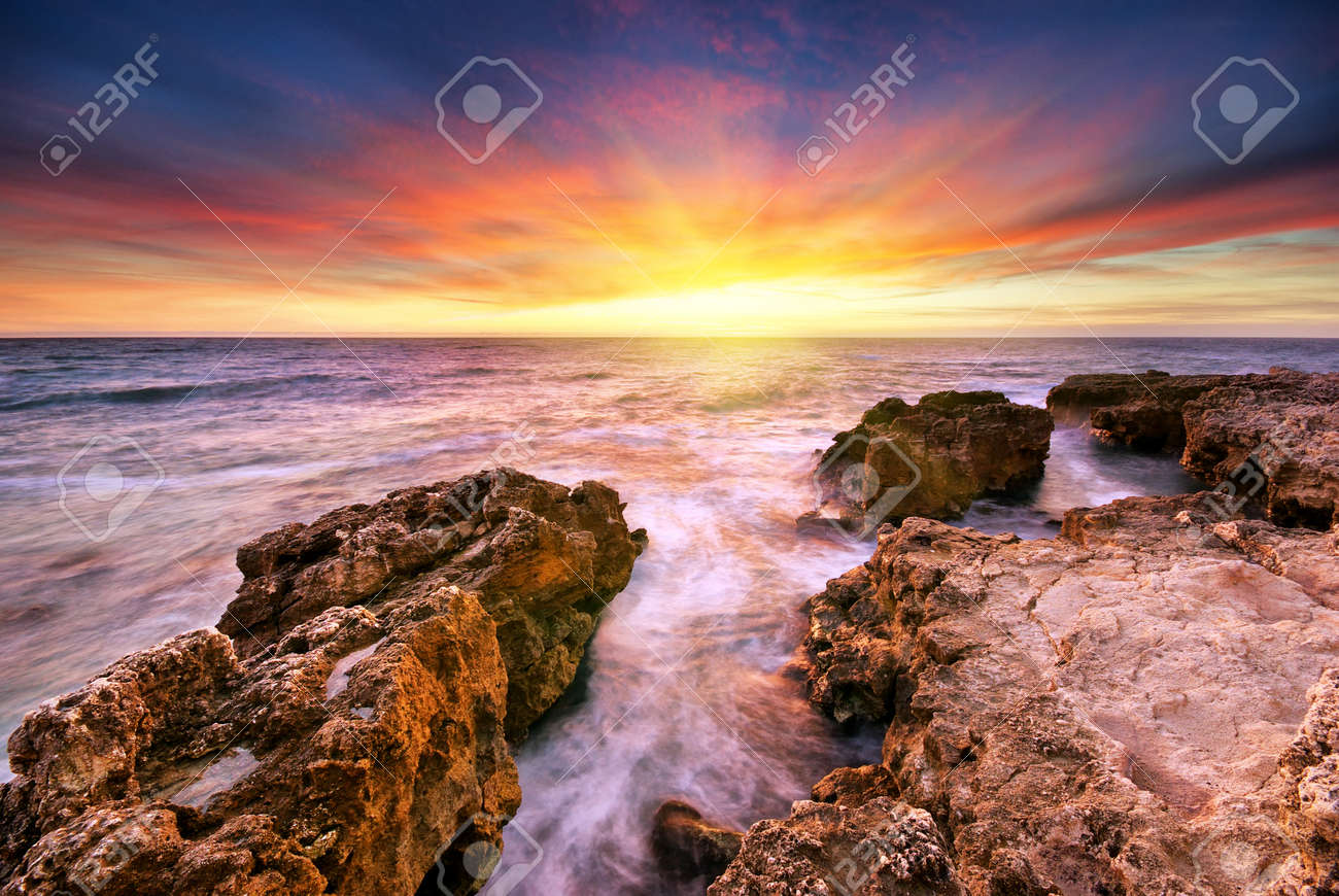 Beautiful seascape. Sea and rock at the sunset. Nature composition. Stock Photo - 14790663