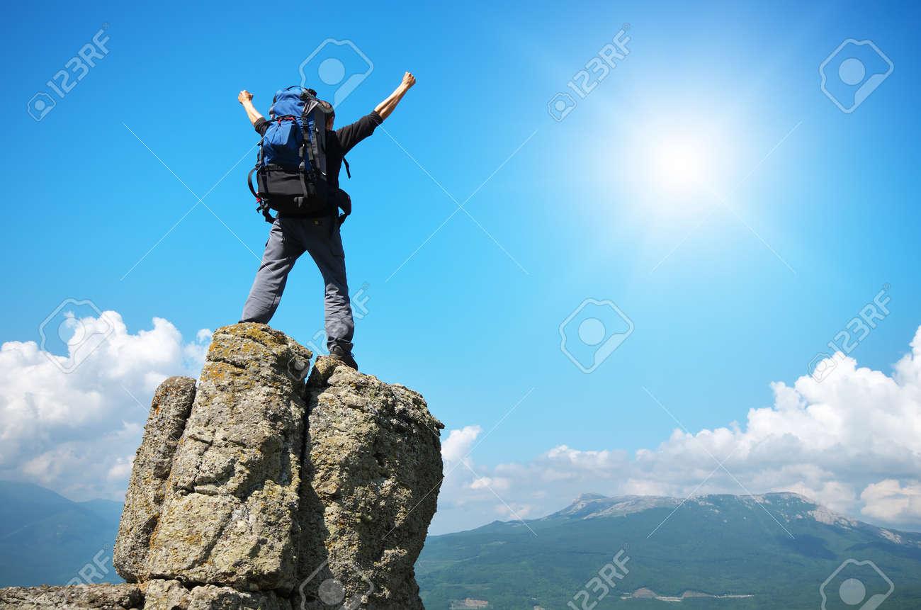 Man on peak of mountain. Emotional scene. - 42999689