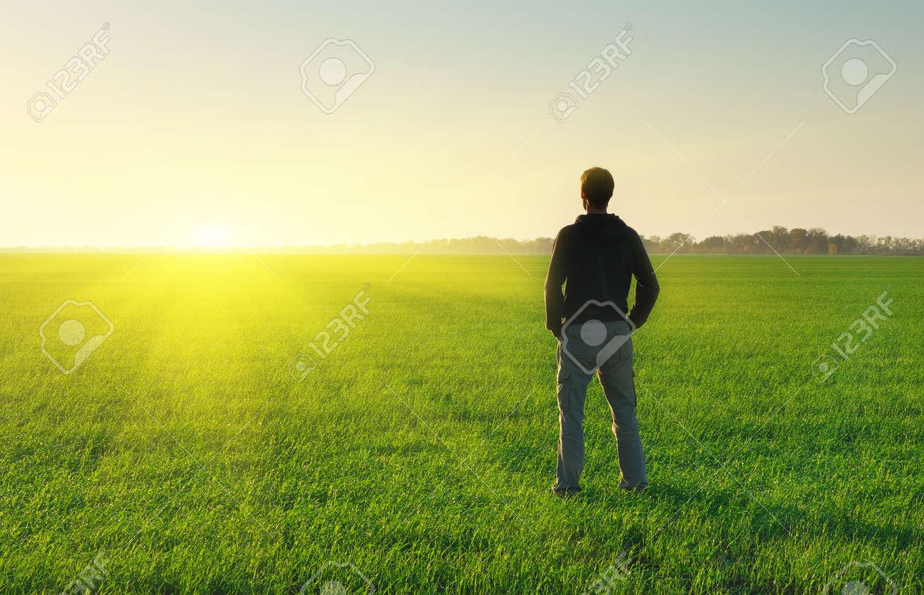 Man in meadow green meadow. Conceptual scene. - 52410586
