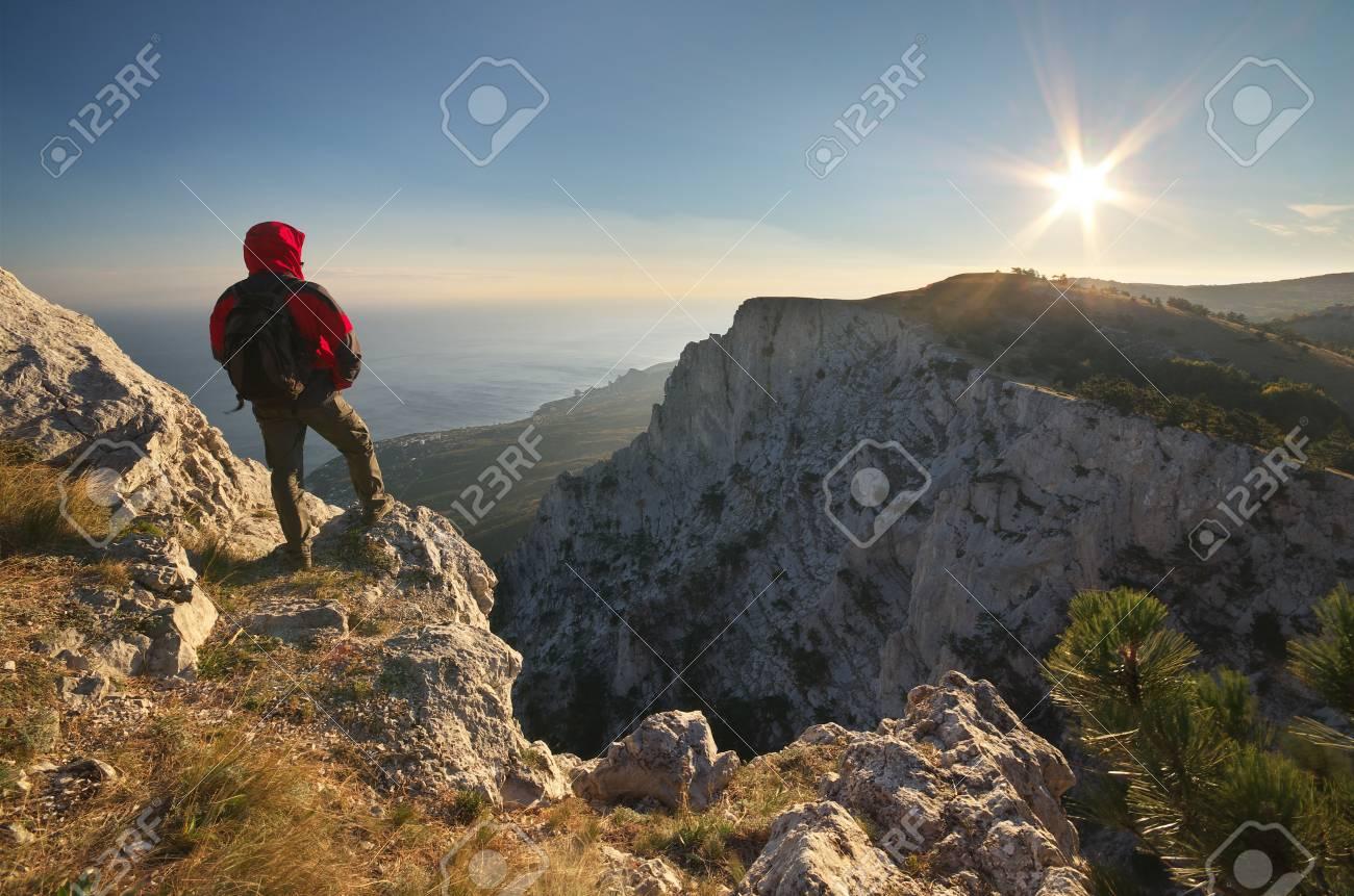 Man on top of mountain. Conceptual design. - 63943285