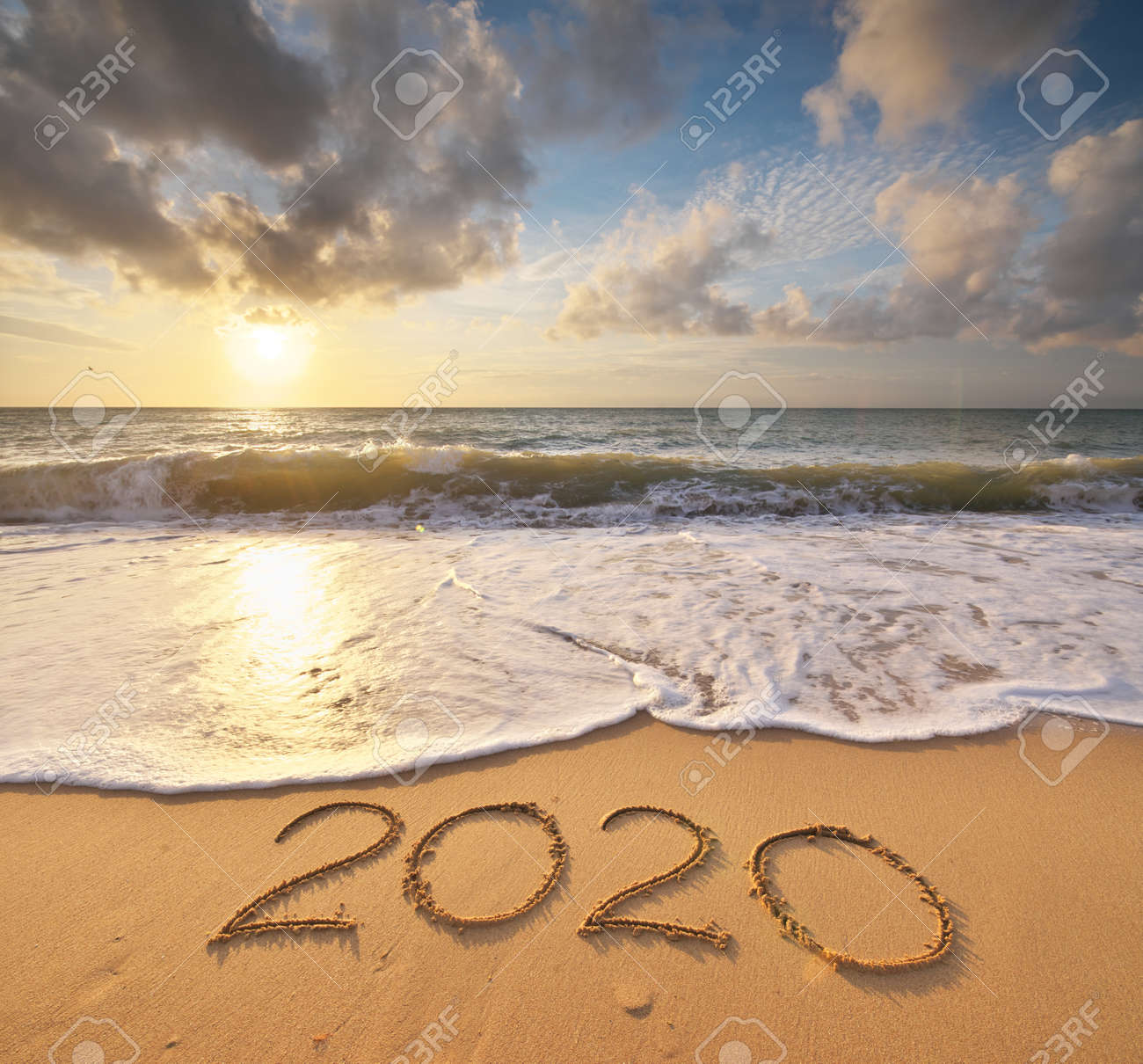 2020 year on the sea shore during sunset. Element of design. - 135152677