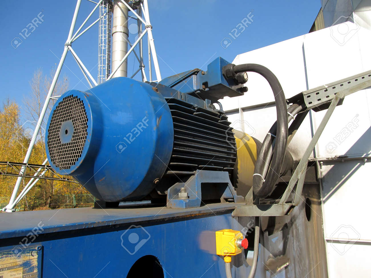 large electric motor of blue color as the drive to the exhaust fan Stock Photo - 23864393