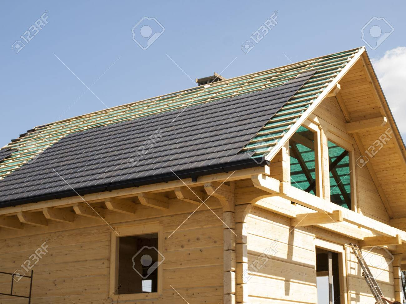 Performance Of Ceramic Tiled Roof For A Wooden House Stock Photo ...