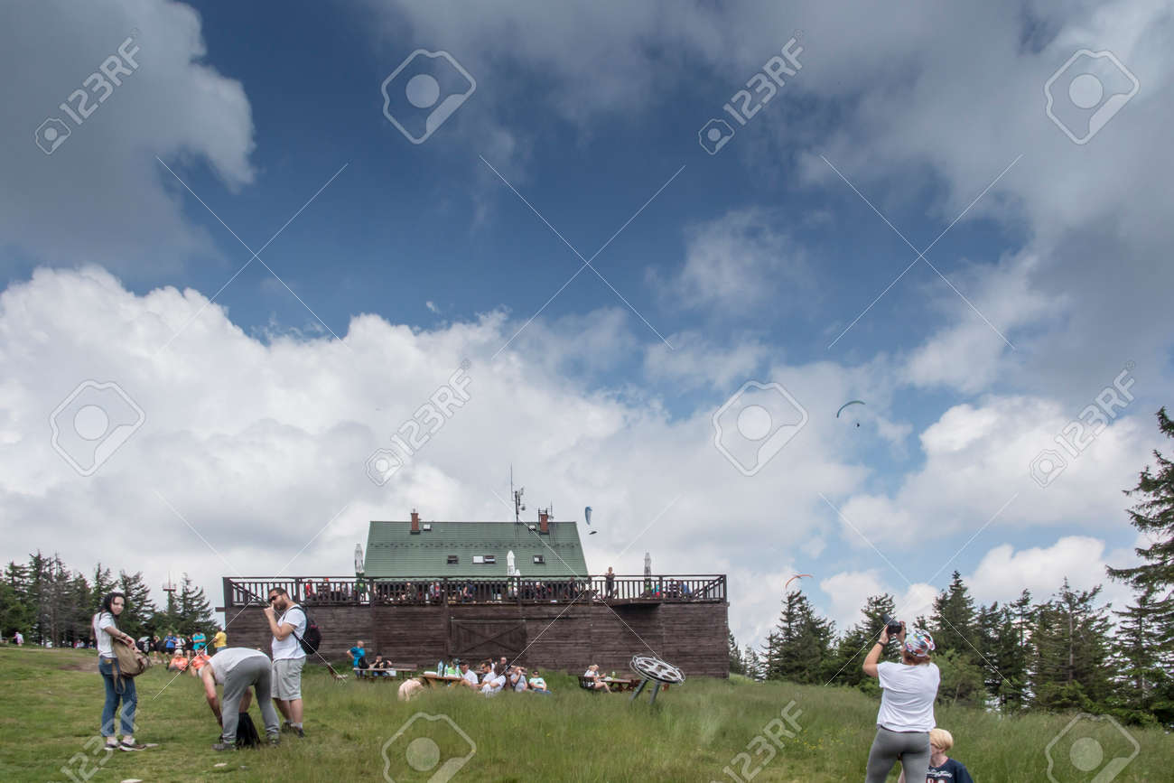 Skrzyczne, Poland, July 04, 2020: Peak, with a tourist hostel, meteorological station and telephony tower and chair lift station in Beskid Slaski Mountains (Poland) - 158012839