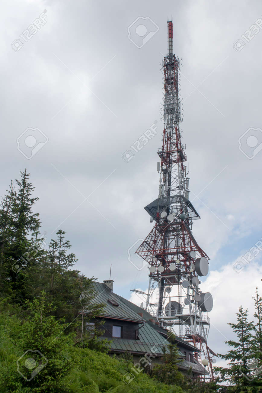 Skrzyczne, Poland, July 04, 2020: Peak, with a tourist hostel, meteorological station and telephony tower and chair lift station in Beskid Slaski Mountains (Poland) - 158013169
