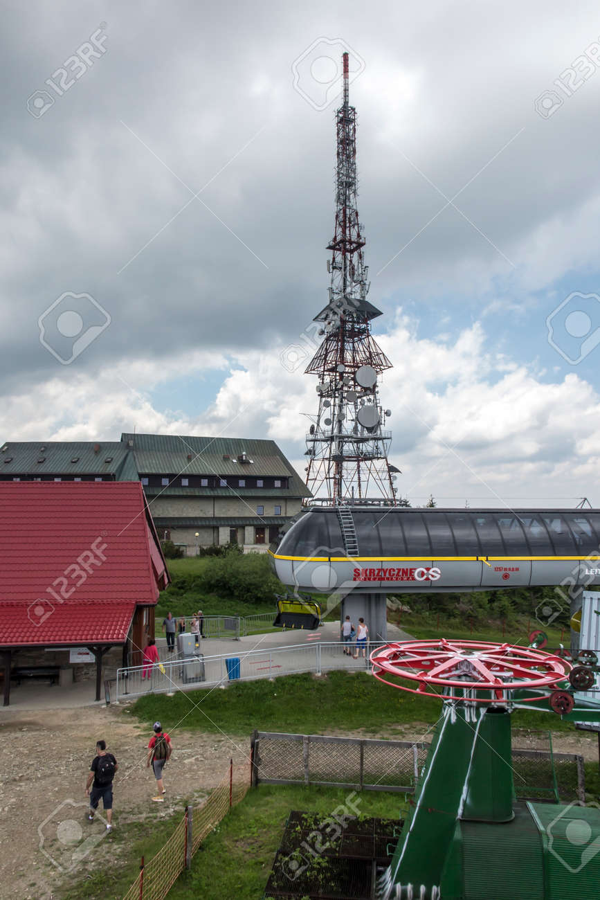 Skrzyczne, Poland, July 04, 2020: Peak, with a tourist hostel, meteorological station and telephony tower and chair lift station in Beskid Slaski Mountains (Poland) - 158012841