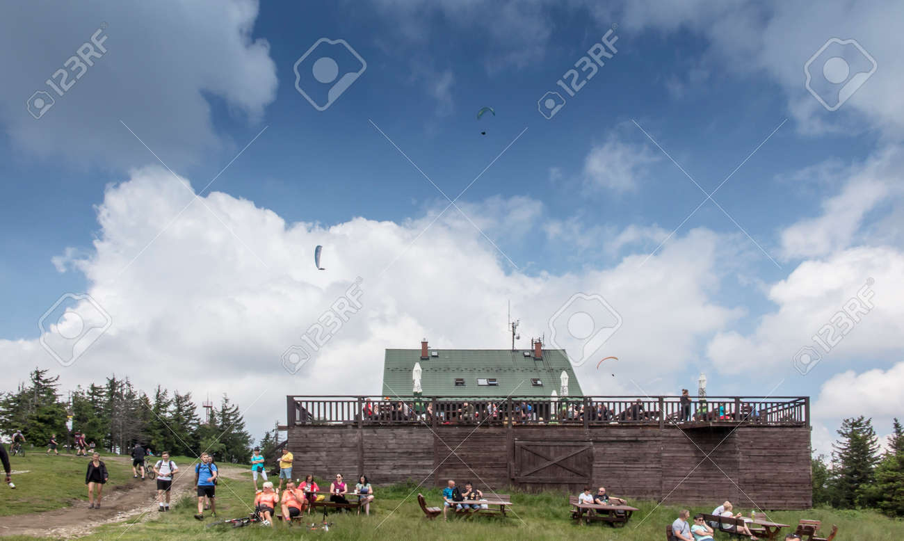 Skrzyczne, Poland, July 04, 2020: Peak, with a tourist hostel, meteorological station and telephony tower and chair lift station in Beskid Slaski Mountains (Poland) - 158012842