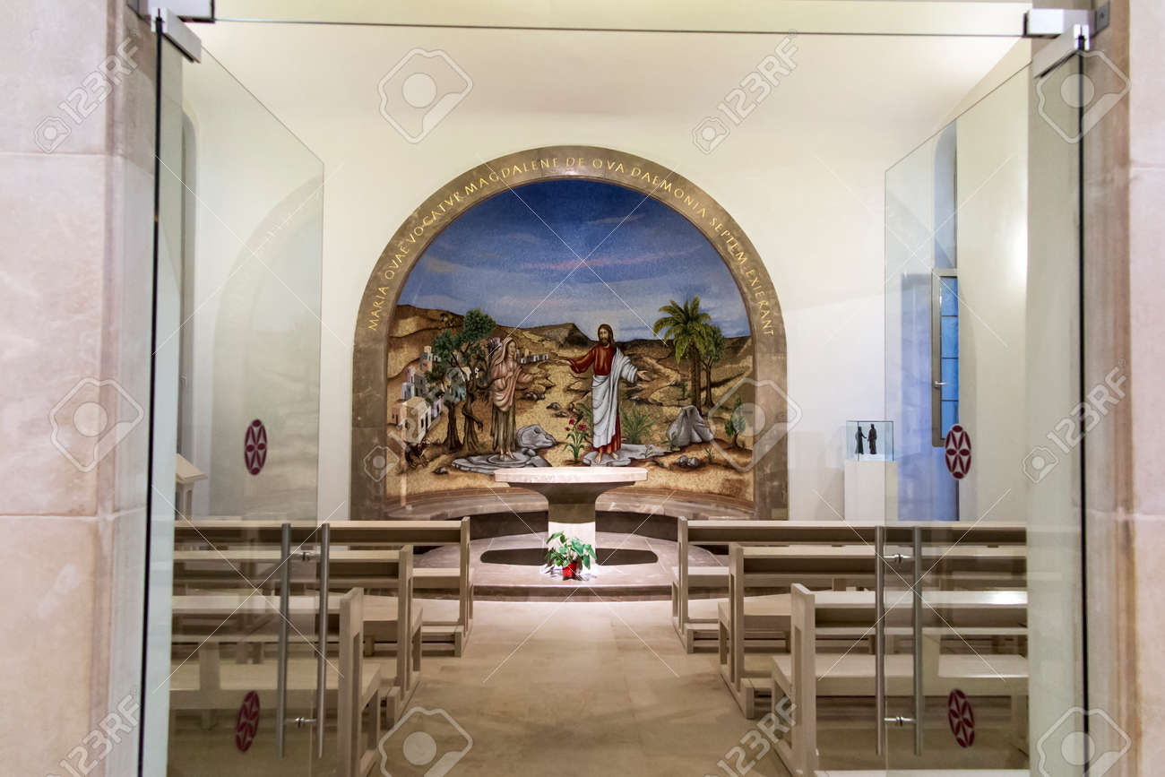 Magdala, Israel, January 26, 2020: Side altar in the church in Magdala on the Galilee Lake (Tiberiacn) with a mosaic depicting Jesus and Mary Magdalene who was left by seven evil spirits - 158013159