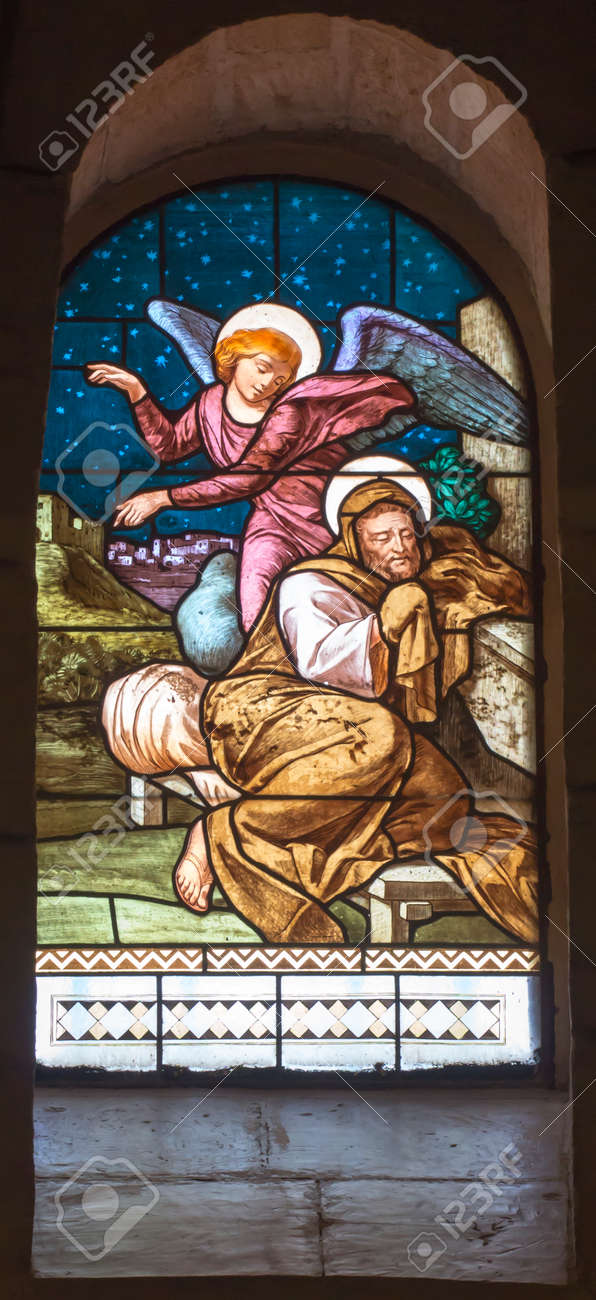 Nazareth, Israel. January 26, 2020: St. Joseph's Church, stained glass window, details. The Angel Appears to St. Joseph in a dream. - 158443605