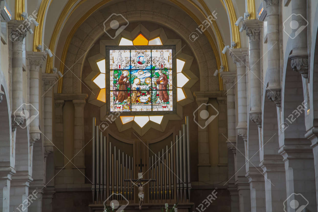 Bethlehem, Palestine. January 28, 2020: Interior of the Church of St. Catherine, stained glass window above the altar - 158443609