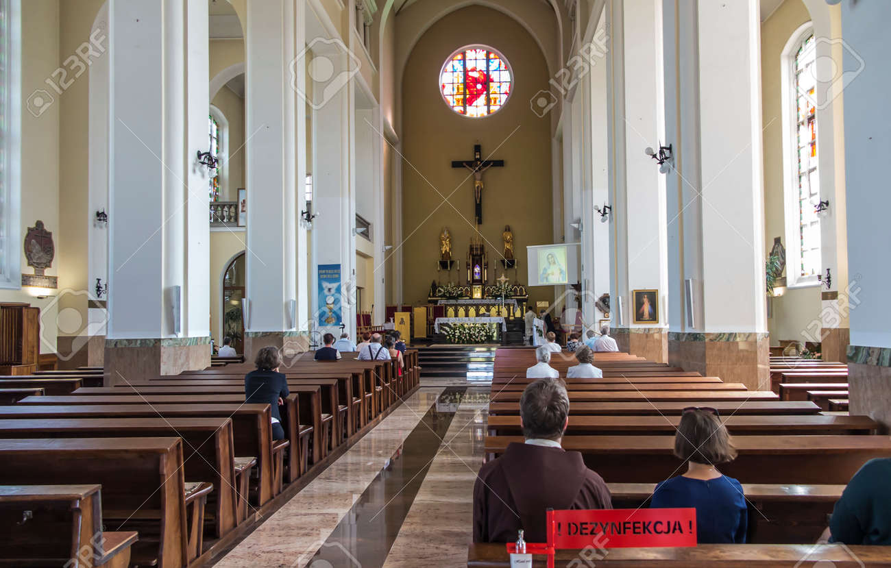 Czestochowa, Poland, August 22, 2020: Interior of the Church of the Exaltation of the Holy Cross in Czestochowa. In the foreground, the place where hands were disinfected during the Covid-19 epidemic. - 157892598