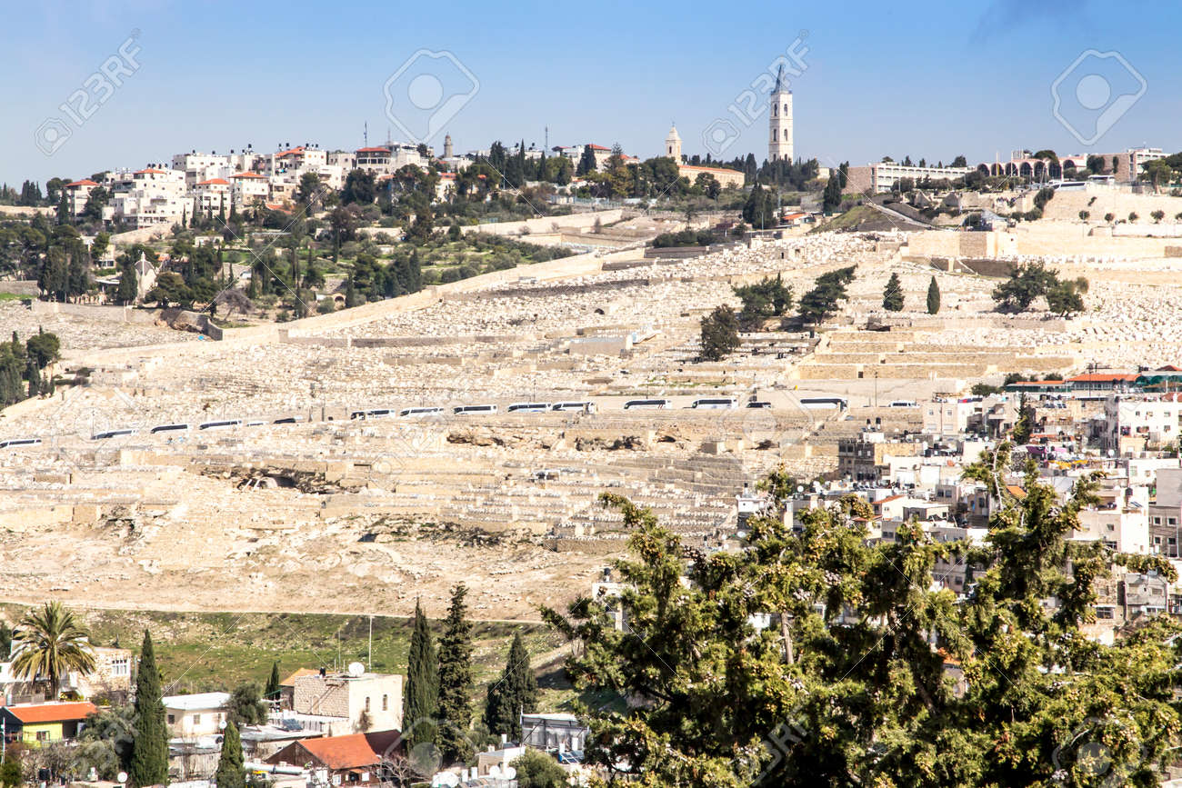 Dense buildings in one of the Jerusalem areas in Israel as a backdrop. The Mount of Olives is visible with one of the most expensive cemeteries in the world. - 157852480